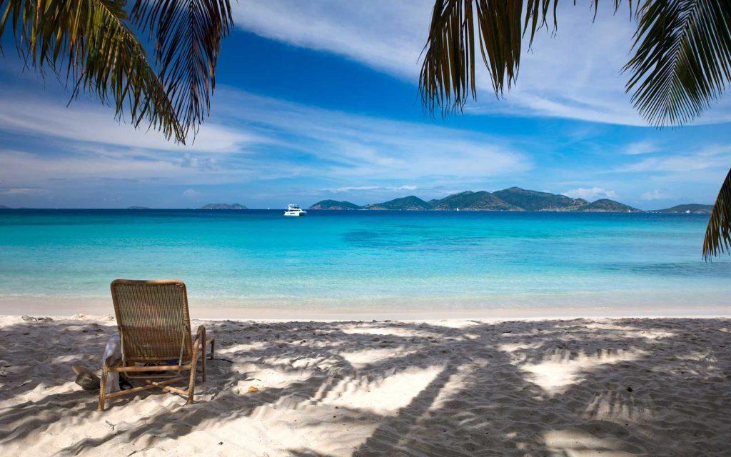 beach chairs under palms tree, smuggler's cove, Tortola